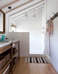 Country Bathroom - White subway tile and a striped rug in a bathroom
