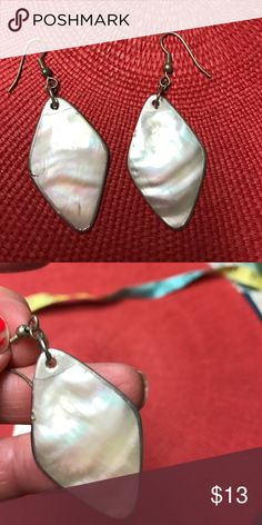 Pierced earrings Lovely white shell earrings with opal like iridescent shades set in diamond shaped frames of sterling silver. Lightweight and great for Summer. Jewelry Earrings