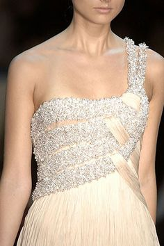 giorgio armani privé. Love the wrapping/weaving detail, but too much glitz for my liking. Would look great with similar textures in different colours.