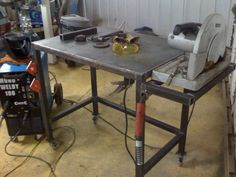 Welding Table by Gonzalo Bravo -- Homemade welding table constructed from steel plate and square tubing. Caster-mounted for enhanced mobility. A side platform provides a base for power tools. http://www.homemadetools.net/homemade-welding-table-20