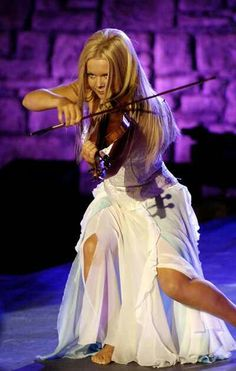 Mairead Nesbitt from Celtic Woman. Is it sad I know exactly what song she is playing in this photo?