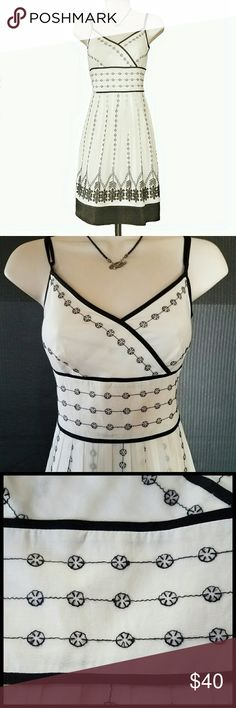 Ann Taylor Sundress Off white sundress w/ black piping, embroidery detail and hem border. Dress and lining are 100% cotton, embroidery 100 % polyester. Invisible underarm zipper. Great condition. Ann Taylor Dresses