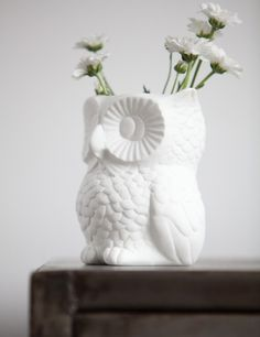 i love the all white owl vase, it takes something very traditional and outdoorsy with a soft modern look