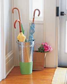 Transform an inexpensive flower bucket into a nice-looking umbrella stand by painting the bottom of the bucket with glossy oil-based enamel paint.