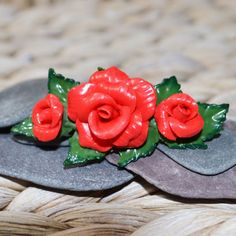 Welcome to Musa Natura, a place where you will find lots of handmade pieces inspired by Nature. Each one lovingly crafted by hand and made to order.  This listing is for a beautiful Red Rose Barrette.  The Red Roses and Leaves have been hand sculpted from Polymer Clay. Each Leaf painted by hand and set onto a Silver Tone Barrette.  The Flowers and Leaves are sized at 2.5 inches (approximately 6 cm), the Barrette clip itself at the back is sized at 2 inches (approximately 5 cm). Your Barrette…