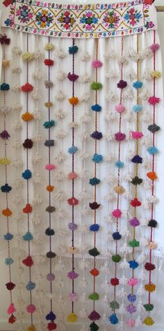 Pom Pom Curtain. Floor length pompom curtain, hand loomed and hand embroidered with natural tints by artisans from Ayacucho, Peru. Each piece is a unique piece of art. Perfect for doorways, inside or outdoors. 100% Wool by Carolina K
