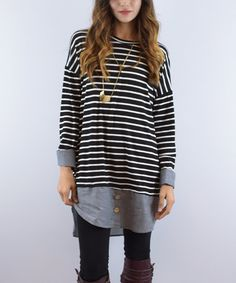 Boasting a stripe pattern on top and a classic chambray layer peaking out from underneath, this tunic effortlessly creates a chic layered look.95% polyester / 5% spandexHand washMade in the USA