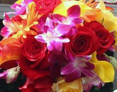 Colorful bouquet of roses, orchids and cala lilies.