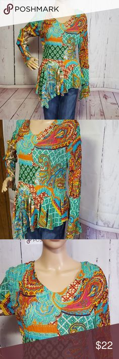 """Essentials by Milano Top This top is great with jeans, jeggins/leggins. So colorful, multi patterned krinkle top. Longer on right hip. Sleeves long and come to a tapered point. 17"""" armpit to armpit (relaxed krinkle state)100% polyester. Like New condition!!!! Milano Tops"""