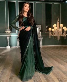 Ayeza Khan seem to be epitome of beauty in the deep emerald green lehnga saari with a velvet pallo by Nomi Ansari showing her charismatic persona. Desi Wedding Dresses, Pakistani Bridal Dresses, Pakistani Dress Design, Indian Dresses, Pakistani Outfits, Stylish Sarees, Stylish Dresses, Trendy Outfits, Girl Outfits