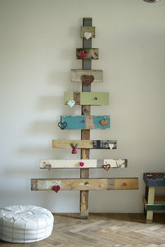Make a tree with old boards, doesn't have to be for Christmas, but can easily be transformed for it