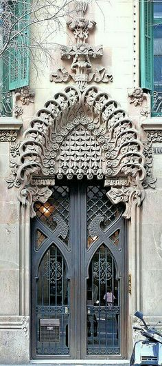 Wow...a beautiful ornate detail above an iron door. I wish I knew where this was!