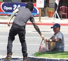 Pete Wentz gives a homeless man groceries.  Why don't you call him a bad person now?He's a short kind person who I really appreaciate. ;)