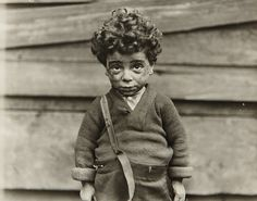 Lewis Hine:  Product of the Tenements, Chicago     c.1907