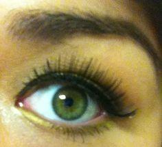 Yellow smokey eye, false lashes, winged shadow