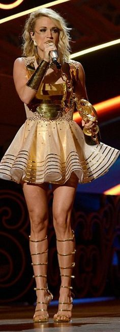 Who made Carrie Underwood's plate dress, gold sandals, and jewelry?