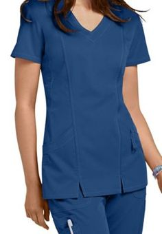 <h4>TIME TO MOVE</h4>On the job, you need to stretch, bend, reach, walk, run, stoop, jump, push, and pull-and that's just for starters.  This fresh scrub top will keep up with you every step of the way, and you'll look amazing all through your workplace workout. NrG by Barco 2-Pocket Mock-Wrap Scrub Top   <ul> <li>Mock wrap <li>Modified V-neck <li>Side panels and fitted back seams <li>Rounded hem <li>Two large patch pockets <li>74 percent Polyester / 22 percent Rayon / 4 percent Spandex…
