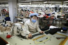 WORKING PORTRAIT: Workers sewed items at a factory in Kaesong, North Korea, Thursday. (Kim Hong-Ji/Associated Press)