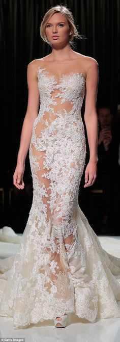 Pronovias designed a dress with a daring see-through S-shaped panel