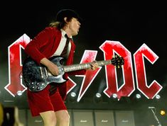 Angus Young Photos - Musician Angus Young of AC/DC performs onstage during day 1 of the 2015 Coachella Valley Music & Arts Festival (Weekend 1) at the Empire Polo Club on April 10, 2015 in Indio, California. - 2015 Coachella Valley Music And Arts Festival - Weekend 1 - Day 1
