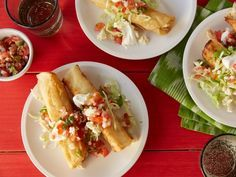 Filled with juicy roasted chicken, these Top-Rated Mini Chicken Tacos are fried until the tortillas are crunchy, then topped with cool crema and homemade salsa. #RecipeOfTheDay