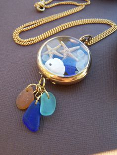 Costa Mar cristal tesoros - collar caso reloj de bolsillo Vintage Star Fish