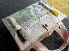 Purple throated flowers with lace Bible cover with bookmark, pockets, and handles.