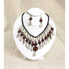 """Double Strand Cowrie & Bead w/Earrings Turn Heads with this beautiful cowrie shell double layer necklace and earring set. Necklace is 12"""" long, earrings are 2"""" big, and strands of beads with cowry shells are 2.5"""" long. (Dark Brown)"""