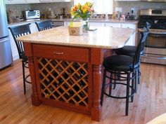 Kitchen island with storage space for all of your favorite wines.