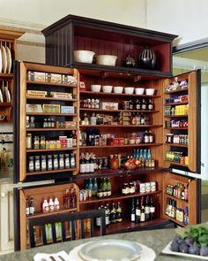 Multi-functional Kitchen Pantry Storage in an Elegant Black Armoire