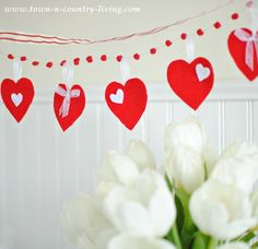 This quick and simple Felt Heart Valentine's Banner will add festivity to your home wherever you hang it! Read the tutorial and see how easy it is to make!