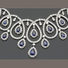 A sapphire, diamond and eighteen karat white gold necklace