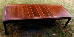 Artisan Furniture & Cabinetry    Cocobolo Rosewood dining table with brass bar inlays.  Seats 6 to 10