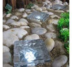 interesting use of glass blocks - solar light ice bricks,,,these could be fun..place in flower beds.