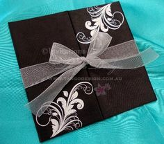 Hard cover fabric wedding invitation with pocket and organza ribbonby Invitations by Tango Design #hardcoverinvitation #hardcoverinvitations #blackwedding