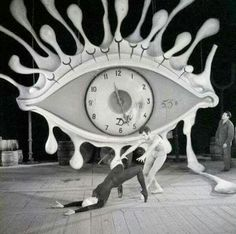 04 Apr 1962, Brussels, Belgium: Some characteristic symbols of the unique art of Salvador Dali- eye, clock, crutches- dominate the stage of the Theatre Royale De la Monnaie in Brussels as Ludmilla Tcherina, famed ballerina, rehearses with partner. Scenery by Salvador Dali.
