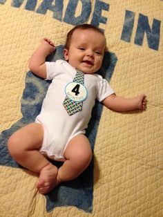 Mudbug Jerret is celebrating four months! Made in Mississippi baby quilt can be found on our State Collection page.