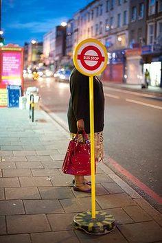 Photograph: Mimi Mollica. A woman waits at a temporary bus stop on Kingsland Road, east London, 2010.