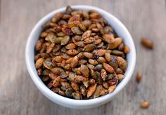 Spicy pumpkin seeds tossed in chili powder, olive oil and a touch of salt are a healthy treat during the Halloween and Thanksgiving holidays.