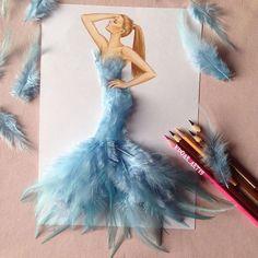 Light blue feather dress by Edgar Artis