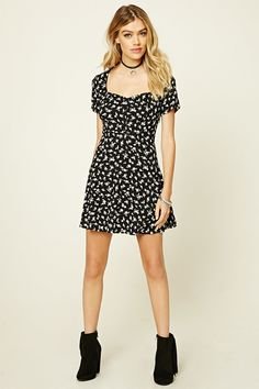 A woven mini dress featuring an allover floral print, partial button-front placket, cap sleeves, a flared silhouette, and a concealed side zipper.