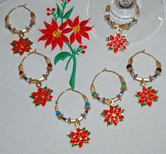 A personal favorite from my Etsy shop https://www.etsy.com/listing/206999233/poinsettia-wine-charms-set-of-6-gold