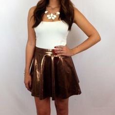 Rose Gold Skirt Rose gold skater skirt. Size small. Price firm unless bundled  Boutique Skirts Circle & Skater