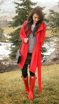 Red belted trench coat paired with grey and black