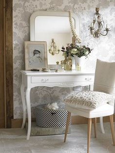 I would love a small vanity area in my room someday. It must be white with a dainty chair.