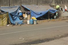 Street Slums On Mumbai Highway, via Flickr.