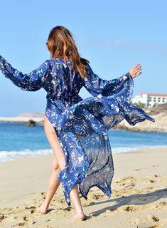 Sydne Style wears paloma blue floral kimono for beach vacation outfit ideas