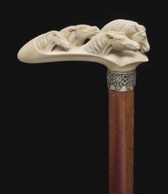 A VICTORIAN IVORY ANIMAL CANE