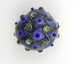 Artisan glass lampwork focal bead in blue and dark wisteria di alessiafuga su Etsy