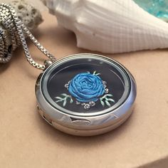 Beautiful! This is a one of a kind hand embroidered locket, it would be a great gift for teens, moms, grandmas, teachers and friends. Floral Rose embroidery pendant necklace.      https://www.etsy.com/listing/254047869/embroidered-necklace-embroidery-jewelry
